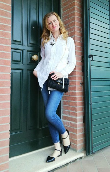 white blouse, denim and elegant black accessories