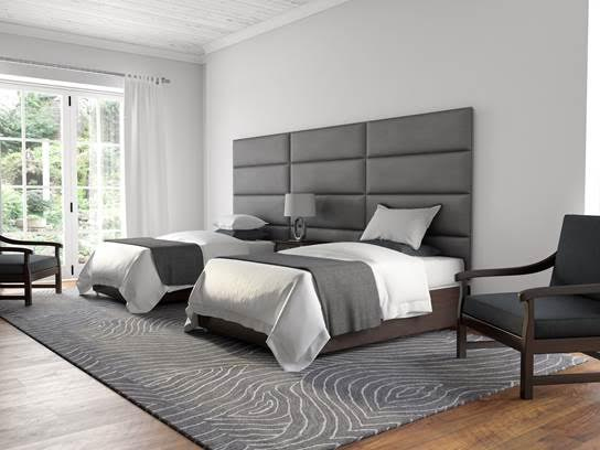 Gray, padded, luxury wall panels behind beds