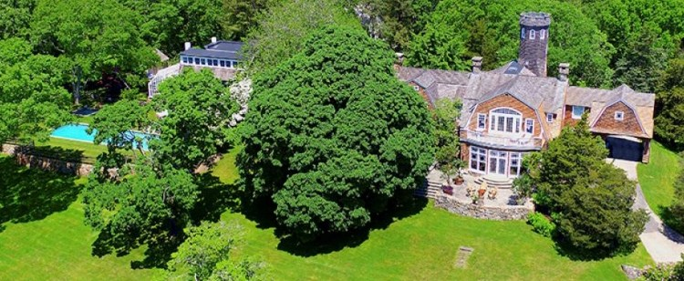 Christie Brinkley's home for sale, aerial view of mansion among trees