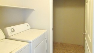 Laundry with shelf and access to walk-in storage closet with hanging rod and shelving - 5303 N 7th St, Phoenix AZ - Laundry Room and walk-in storage closet, washer and dryer included - Bill Salvatore, Arizona Elite Properties 602-999-0952 - Arizona Real Estate