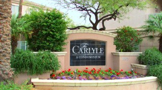 Attractive 'The Carlyle' monument backed by shade trees and planted with brightly colored flowers - 5303 N 7th St, Phoenix AZ - Desirable Carlyle Condominiums in the heart of Phoenix - Bill Salvatore, Arizona Elite Properties 602-999-0952 - Arizona Real Estate