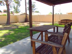 Wood table and chairs on covered, concrete patio in back yard - 783 W Park Ave, Chandler Arizona - Covered patio and big back yard - Bill Salvatore, Arizona Elite Properties 602-999-0952 - Arizona Real Estate
