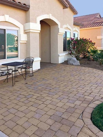 Patio made of pavers with small bistro table in front of house - 1151 S Sandstone Street, Gilbert Arizona - Front Patio - Bill Salvatore, Arizona Elite Properties 602-999-0952 - Arizona Real Estate