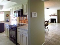 angle view of kitchen on left, open via pass-through and entrances at either end to open family room - 783 W Park Ave, Chandler Arizona - Freshly painted interior - Bill Salvatore, Arizona Elite Properties 602-999-0952 - Arizona Real Estate