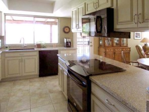 Kitchen with cream color cabinets, neutral tile floor and black appliances - 783 W Park Ave, Chandler Arizona - Remodeled Kitchen - Bill Salvatore, Arizona Elite Properties 602-999-0952 - Arizona Real Estate