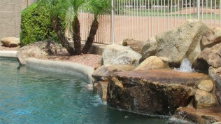 Close up of rock water feature with two small bubbling fountains - Pebble Tec Pool with Water Feature - 1205 S Sandstone Street, Gilbert AZ 85396 - Western Skies Golf Community - Bill Salvatore, Arizona Elite Properties 602-999-0952 - Arizona Real Estate