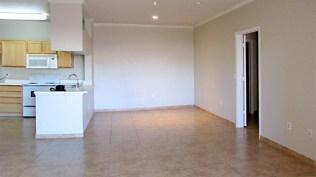 Open living, dining and kitchen with light walls and tile floors - Red Rox Condominiums - 5401 E Van Buren St, Phoenix AZ - Unit #3002 - Large tiled greatroom - Bill Salvatore, Arizona Elite Properties 602-999-0952 - Arizona Real Estate