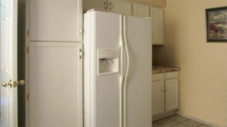 White kitchen cabinets with white countertop, floor to ceiling cabinet beside white refrigerator - 945 N Pasadena, Mesa AZ - Park Centre Patio Homes - Bill Salvatore, Arizona Elite Properties 602-999-0952 - Arizona Real Estate