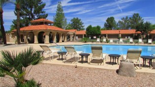 Cool decking with pool lounges and tables beside sparkling blue swimming pool - 945 N Pasadena, Mesa AZ - Park Centre Patio Homes - Bill Salvatore, Arizona Elite Properties 602-999-0952 - Arizona Real Estate