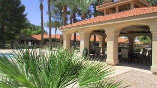 Pygmy palms in foreground, covered picnic ramada with red tile roof and arched entry ways all around, beside community pooln- 945 N Pasadena, Mesa AZ - Park Centre Patio Homes - Bill Salvatore, Arizona Elite Properties 602-999-0952 - Arizona Real Estate