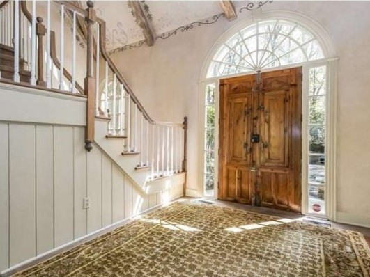 Whitewashed entry foyer with tan oriental rug, double wood doors with paladian window surround, stairway on left - (photo: RIS Media) - Cyndi Lauper's Stamford CT home for sale - Bill Salvatore, Arizona Elite Properties 602-999-0952 - Arizona Real Estate