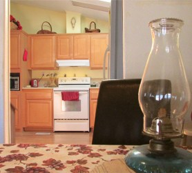view across dining table with oil lamp, toward doorway into kitchen - Great updated kitchen - 161 N 88th Place, Mesa AZ - Bill Salvatore, Arizona Elite Properties - Mesa Arizona property for sale