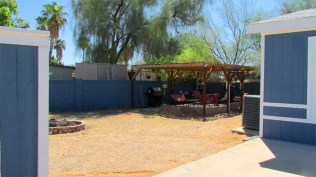 back yard enclosed on 3 sides with block wall painted blue to match house - Large Lot - 161 N 88th Place, Mesa AZ - Bill Salvatore, Arizona Elite Properties - Mesa Arizona property for sale