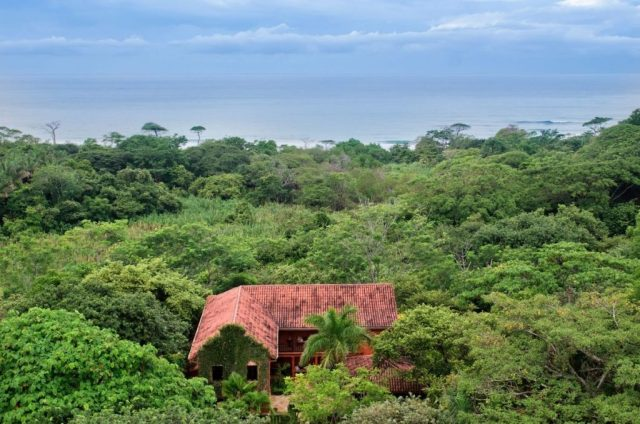 Aerial view, roof of home among jungle greenery and ocean beyond - Aerial of home and ocean - Mel Gibson's Costa Rica house for sale, Costa Rica Vacation property, Luxury home on Costa Rica - Bill Salvatore, Arizona Elite Properties 602-999-0952 - Costa Rica Real Estate for Sale