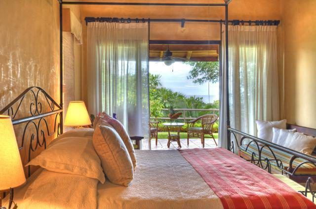 Bedroom with sliding glass wall and distant view of ocean - Bedroom with ocean view - Mel Gibson's Costa Rica house for sale, Costa Rica Vacation property, Luxury home on Costa Rica - Bill Salvatore, Arizona Elite Properties 602-999-0952 - Costa Rica Real Estate for Sale