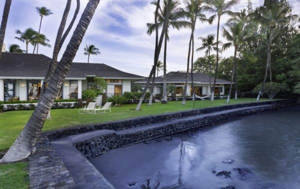sprawling single-level home with manicured ocean frontage and tall palm trees on grassy lawn - Honuala'i Estate on the Big Island of Hawaii, Hawaiian Luxury Real Estate, Homes for Sale in Hawaii, via RIS Media Housecall - Bill Salvatore, Arizona Elite Propeties 602-999-0952 - Arizona Real Estate