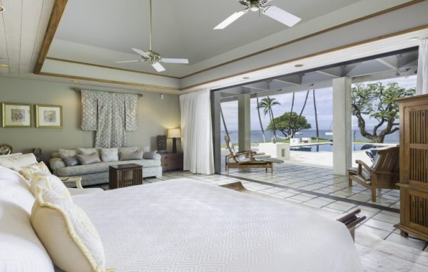 spacious white bedroom with sliding wall open to patio and ocean view - 6 Bedrooms - Honuala'i Estate on the Big Island of Hawaii, Hawaiian Luxury Real Estate, Homes for Sale in Hawaii, via RIS Media Housecall - Bill Salvatore, Arizona Elite Propeties 602-999-0952 - Arizona Real Estate