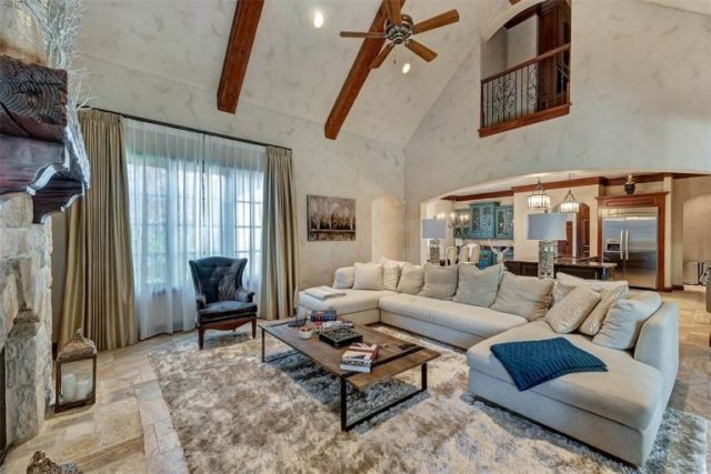 large living room in neutral colors with beamed, vaulted ceiling and large windows - Dining Room - Selena Gomez's Fort Worth Texas Home for Sale - Bill Salvatore, Arizona Elite Properties 602-999-0952 - Arizona Real Estate