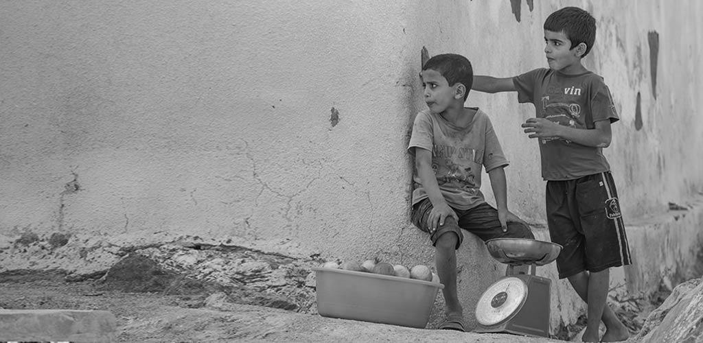 Image of sales teamwork communication and vision, entreupreneurial kids selling on a street corner