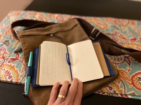 The Traveler's Notebook has a cover with bands that you use to anchor the journal inserts. It's like having multiple thin journals in one, creating the option to use one section for more tactical things like itineraries and packing lists, and another for actual journaling.
