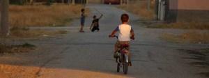 Street children playing on a bike