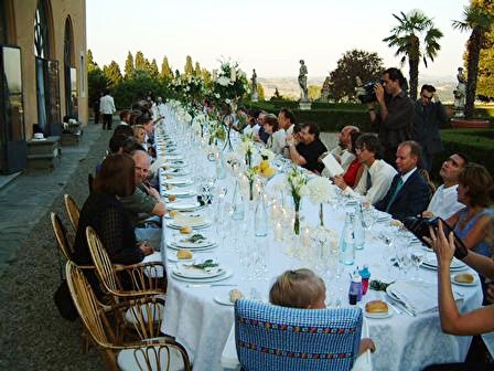 A Tuscan wedding long table daytime
