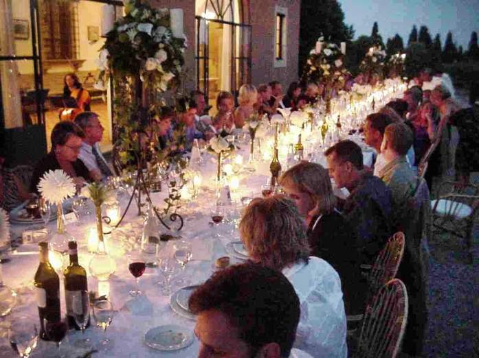 A Tuscan wedding long table dusk