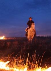 Flying W Ranch cowboy in fire