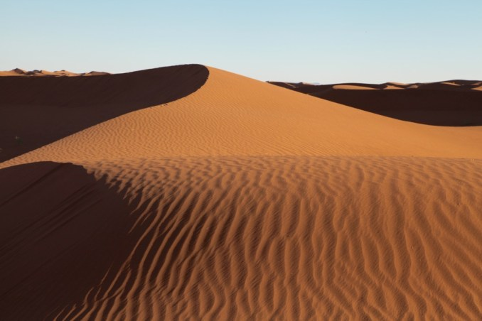 Dar Ahlam Tent Camp sunset dune curve