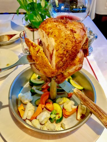 "This is a chicken. A baby chicken at the ‪‎Rosa Alpina‬ hotel in ‎San Cassiano‬ ‎Italy‬. Roasted on a spike, its juices dripping over the seasonal vegetables below as it cooks. Like everything at Rosa Alpina, it's just a little bit different...and better...than you'd ever expect. And this is just the ""regular"" restaurant, not the Michelin Three Star restaurant, so you can do your own math on what that is like..."