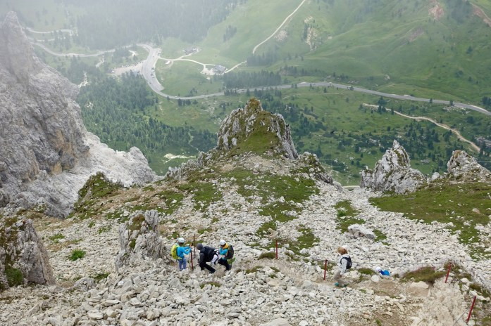 You can't tell, but these people are standing atop a 3000 ft dropoff, about to head down the via ferrait trails. -- a trail with iron holdins that the Austrian troops used to safely mobilize across these scary high peaks.