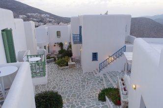 Anemomilos Apartments walkway at dusk