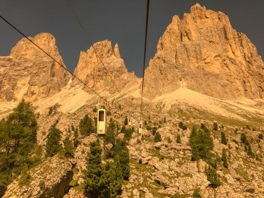 You take a goofy two-man standup lift that you load-in like a Roman chariot to the top of Sassalungo (one of the most pokey-outest of the Dolomite formations).