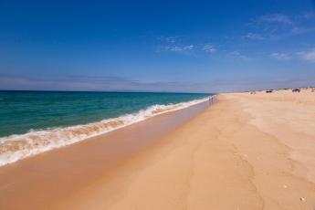 ... and smooth sand for as far as the eye can see.
