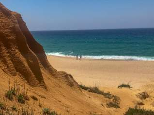 Then suddenly the small orange canyon opens up to the view of the beach.