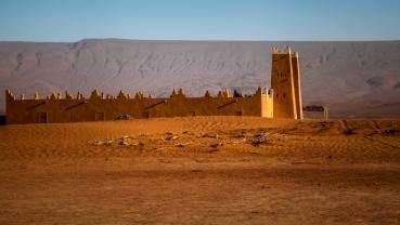 Leaving in the early morning, we took a different way back, stopping by ancient desert forts, some thousands of years old.