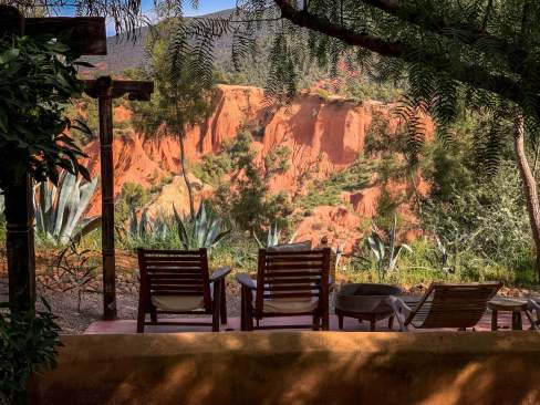 The dining area overlooks enchanting red rock formations, perfect for an aperativo.
