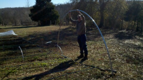 Erecting a hoop house for extended season growing.