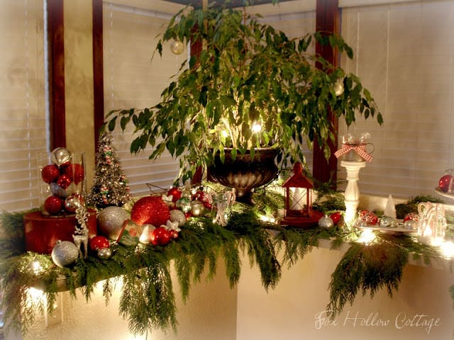 Christmas centerpiece and decor using ornaments twinkle lights and cedar boughs