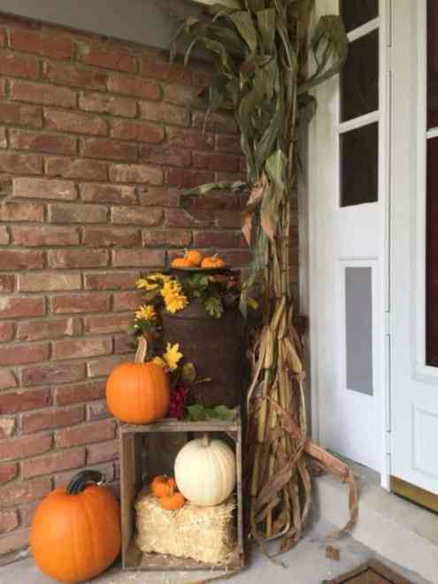 Front porch fall decorating with crates, corn stalks, pumpkins
