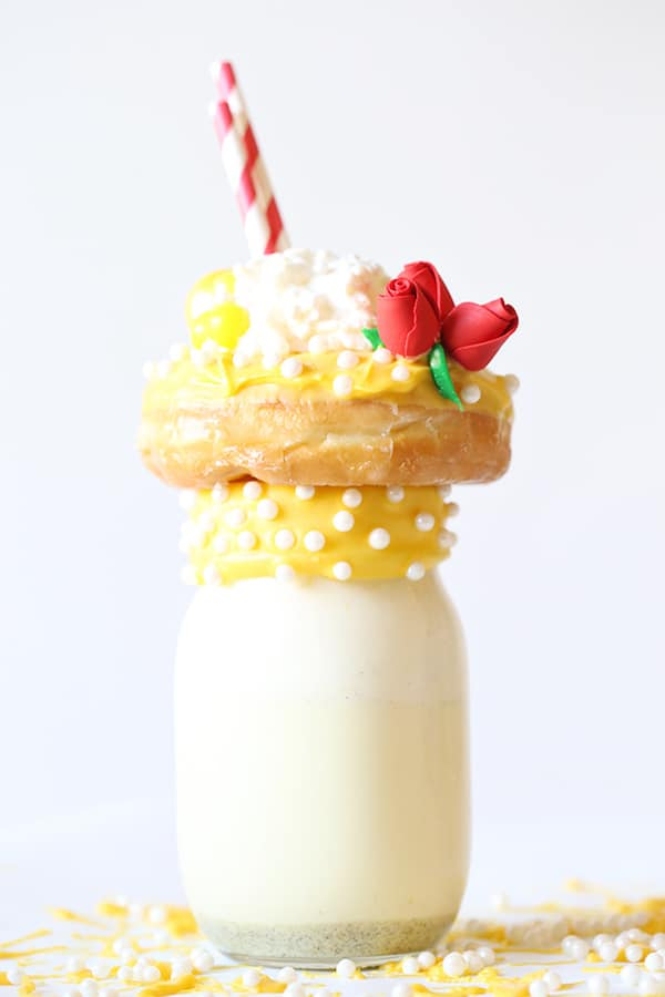 Yellow icing on donut on top of milkshake