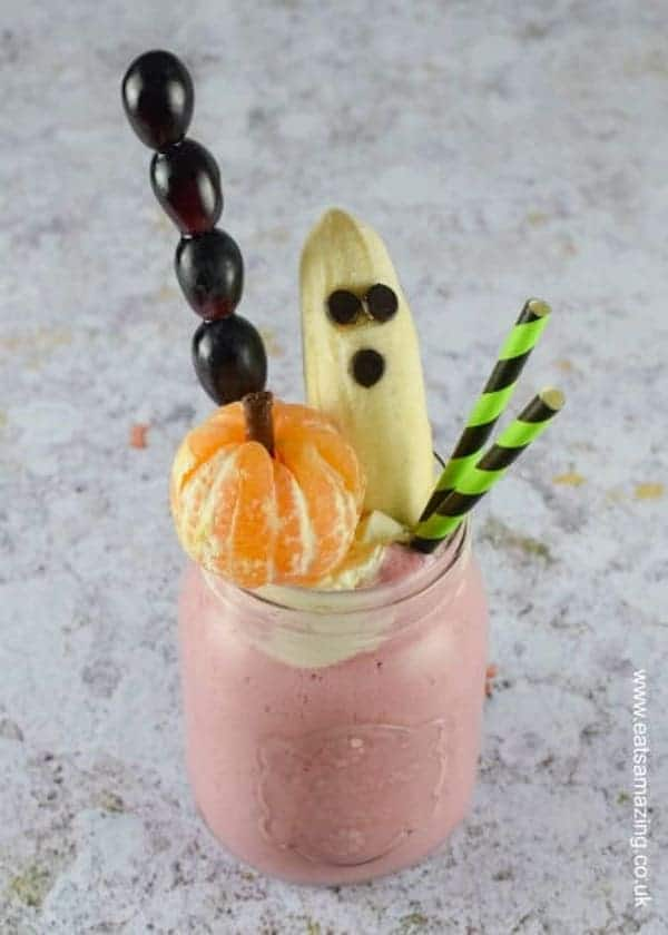 Healthy freakshake topped with grapes, orange, and banana