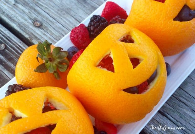 Halloween fruit ideas: orange jack-o-lantern fruit salad