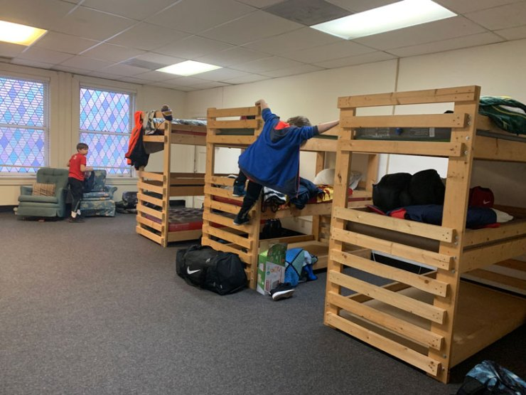 Two artist checking out their bunkbeds.