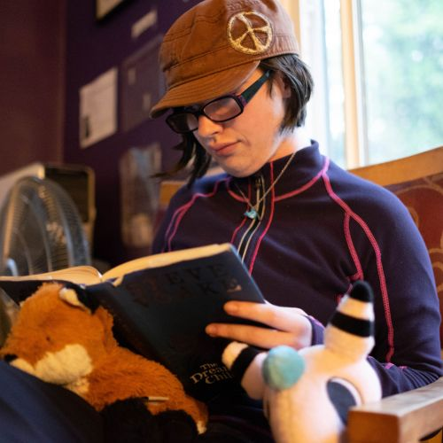 young person reading book