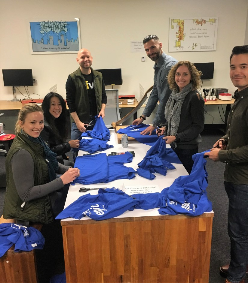 Volunteer group making t-shirt bags