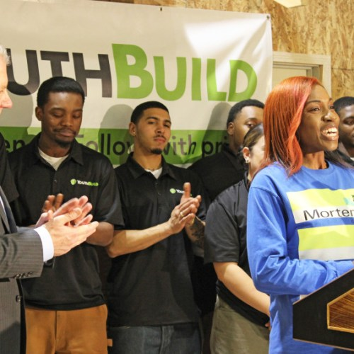 Youthbuild graduate speaking at press conference