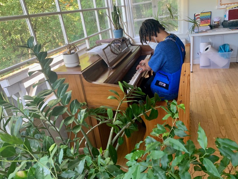 Youth playing piano at YouthCare's Passages housing program