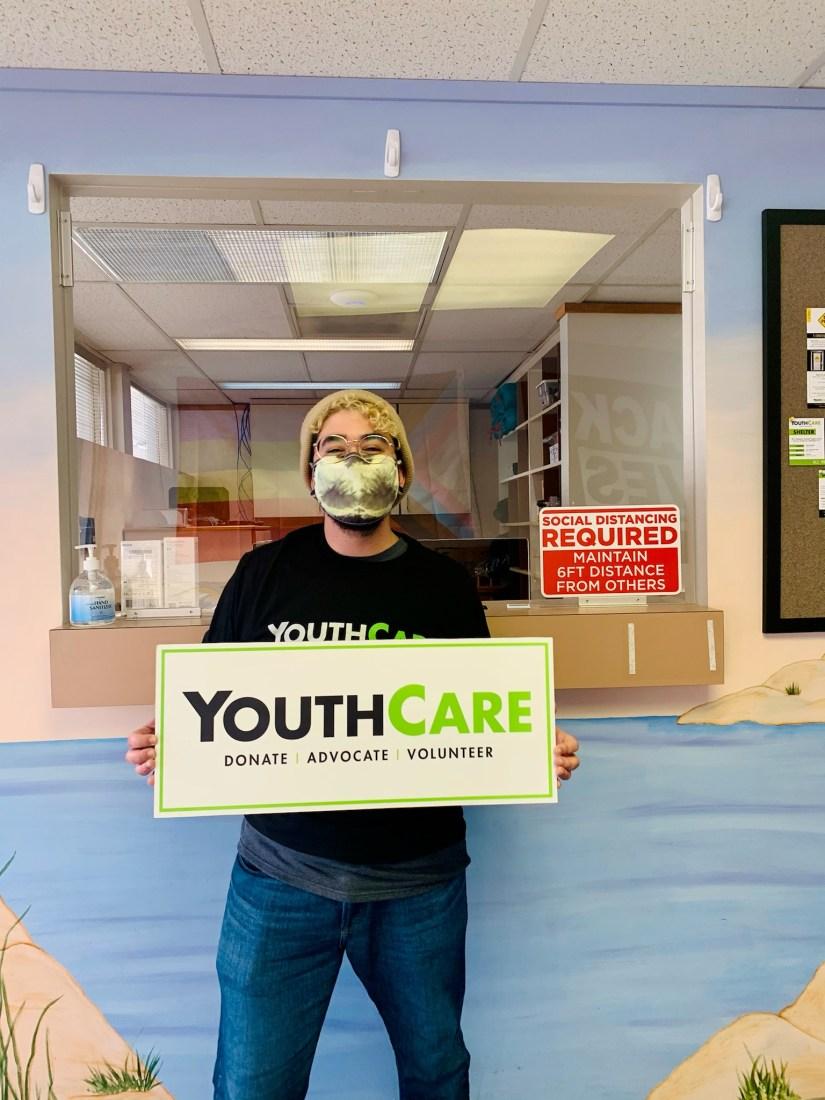 Sam holding YC sign inside yRC