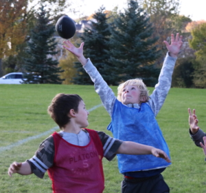 A flag football player goes for a circus catch!